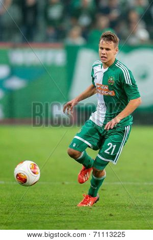 VIENNA, AUSTRIA - AUGUST 22 Louis Schaub (#21 Rapid) runs with the ball at a UEFA Europa League game on August 22, 2013 in Vienna, Austria.
