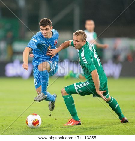 VIENNA, AUSTRIA - AUGUST 22 Christopher Dibon (#17 Rapid) and Giorgi Iluridze (#10 Dila Gori) fight for the ball at a UEFA Europa League game on August 22, 2013 in Vienna, Austria.