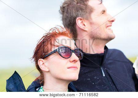Couple in summer rain shower at German north sea coast