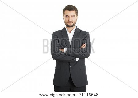 portrait of assured businessman with folded hands over white background