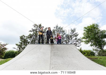 Teenagers Standing On A Halfpipe
