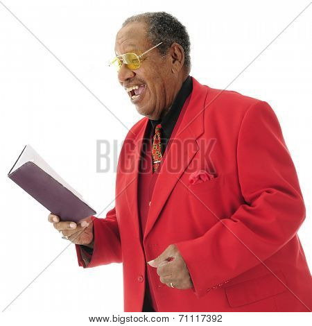 Close-up image of a dressed-up senior African American singing from a hymnal.  On a white background.