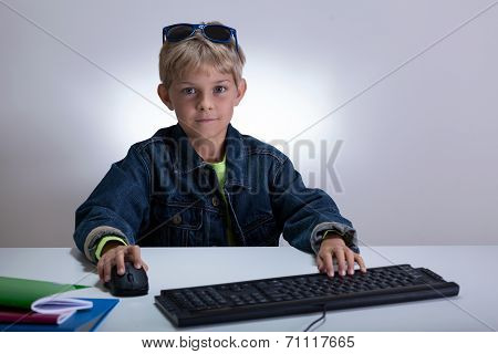Little Student Playing On Computer