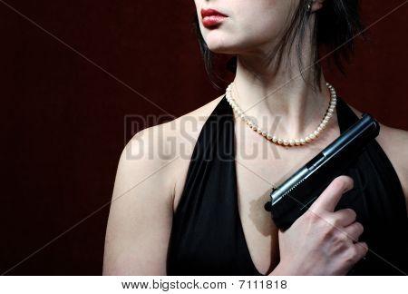 Beautiful Woman In Evening Dress With Gun