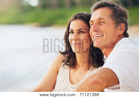 Happy Romantic Mature Couple Enjoying Sunset on the Beach