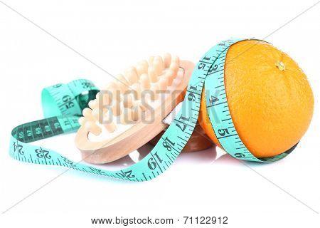 Fresh orange, tapeline and a brush on white background isolated