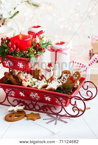 Christmas table decoration with biscuits,flowers and candles