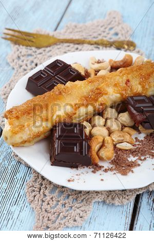 Sweetened fried banana on plate, close-up