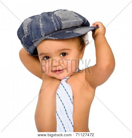 Funny little African baby boy with hat and tie