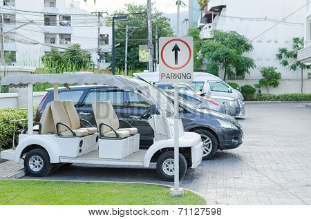 Cars On A Parking Lot And Parking Sign