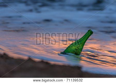 green bottle in sea water