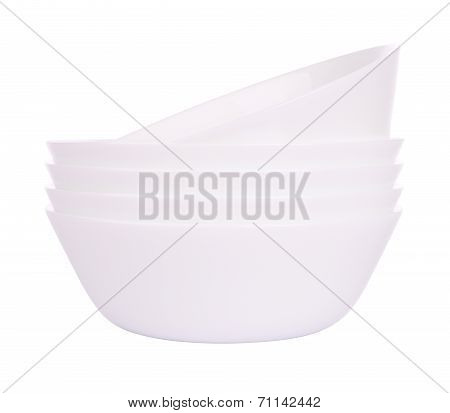 Lean front five round ceramic bowls stack on white background.