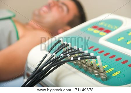 Man receiving an electro therapy at the health center