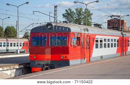 Modern Red Suburban Electric Train Standing At The Station In Russia