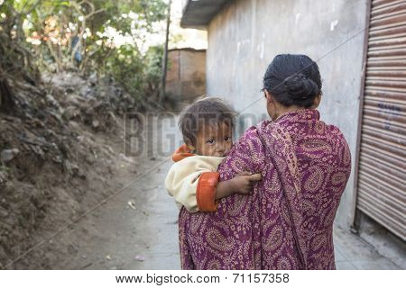 KATHMANDU, NEPAL - DEC 22, 2013: Unidentified local child near their homes in a poor area of the city. The caste system is still intact today but the rules are not as rigid as they were in the past