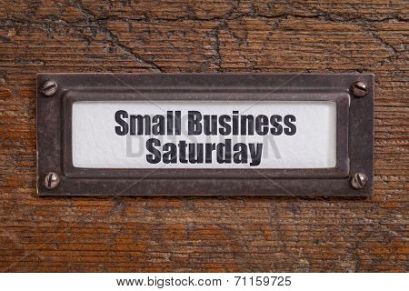 Small Business Saturday - file cabinet label, bronze holder against grunge and scratched wood