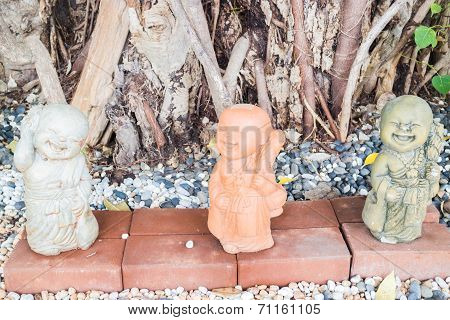 Happy Clay Sculpture Of Little Monks