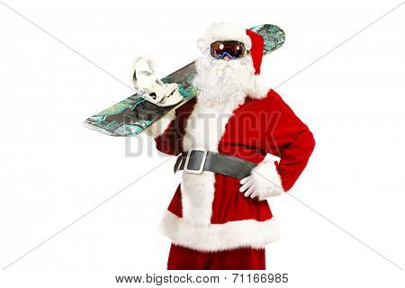 Santa Claus is standing in the ski mask and holding a snowboard. Christmas. Isolated over white.