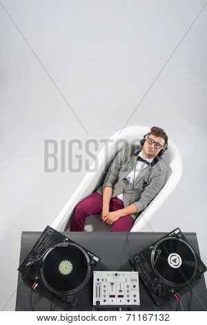 Dj at work in bath isolated on white background