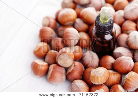 essential oil and hazelnuts - health and beauty