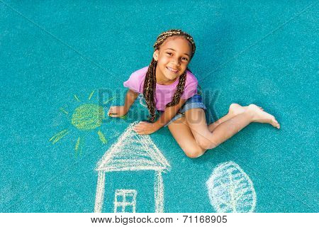 Nice black girl with chalk drawing