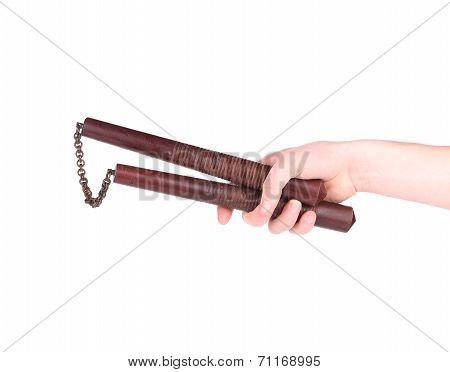 Martial arts nunchaku weapon in hand.