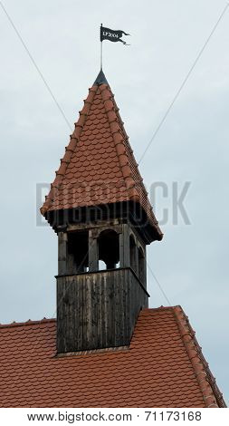 Red chimney roof at the top of the roof with a flag