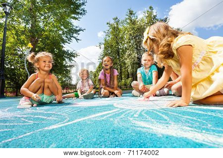 Drawing chalk image on playground