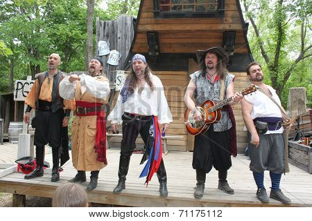 MUSKOGEE, OK - MAY 24: Men dressed in pirate costumes sing the Oklahoma 19th annual Renaissance Festival on May 24, 2014 at the Castle of Muskogee in Muskogee, OK.