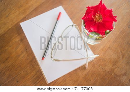 Beautiful Red Rose On Work Table