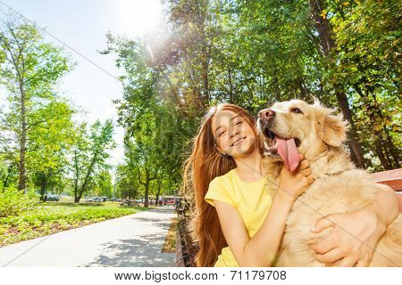 Nice girl with funny retriever dog portrait