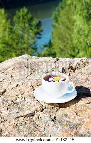 Cup on  rock at mountain view.