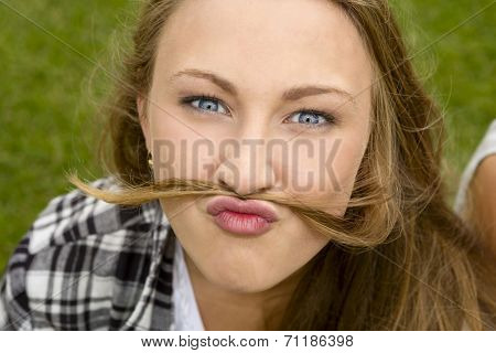 Outdoor portrait of a happy teenage making  funny face