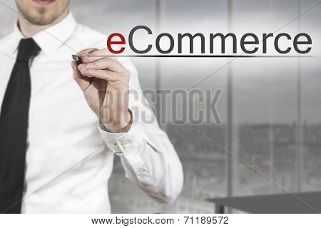 Businessman Writing Ecommerce In The Air