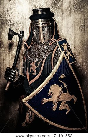 Medieval knight on golden wall background