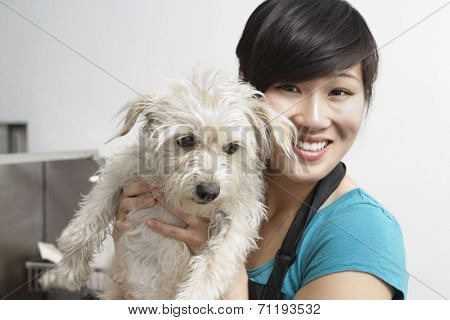 Portrait of smiling young woman with Terrier dog