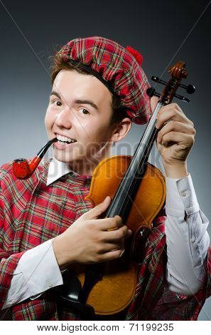 Funny scotsman with violin fiddle