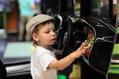 pic of arcade  - Child playing arcade game machine at an amusement park - JPG