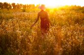 image of beatitudes  - Girl in the hat of wild flowers on a summer evening