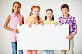 picture of diligent  - Friendly classmates with blank paper looking at camera with smiles - JPG