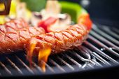 picture of barbecue grill  - Grilling Sausages on barbecue grill  - JPG