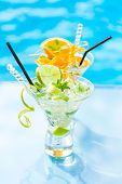 foto of mojito  - Fresh Lime and Orange Mojito with twist by the swimming pool - JPG