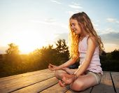 pic of  practices  - Girl meditating outdoors - JPG