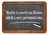 reality is merely an illusion, albeit a very persistent one - a quote from Albert Einstein on a vintage slate blackboard poster