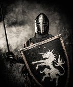 foto of crusader  - Medieval knight against stone wall - JPG