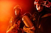 foto of fireman  - Dramatic image of firemen team in uniform - JPG