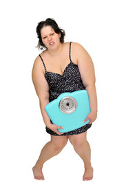 picture of nighties  - Large girl in nightie holding a scale isolated in white - JPG