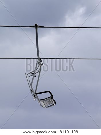 Chair-lift And Gray Sky