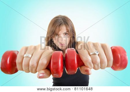 Girl With Weights Or Red Dumbbells Wearing Sports Clothing Isolated Over Blue