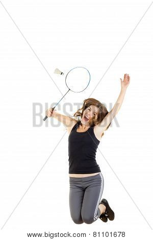 Badminton Player In Action Holding Racket To Catch Shuttlecock